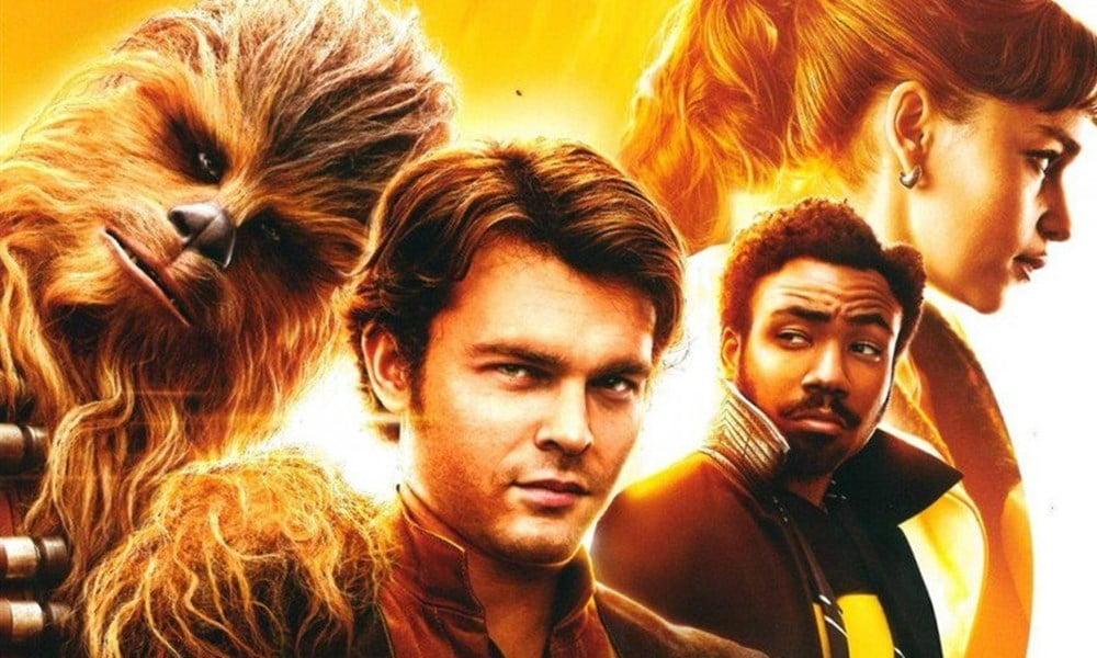 Solo - A Star Wars Story | Cartaz promocional o piloto ao lado de Chewbacca e Lando